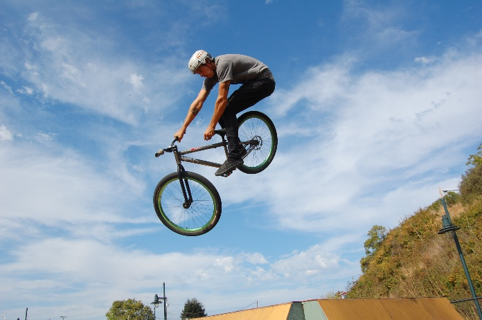 BMX rider jumping off ramp in Depot Park Bike Park