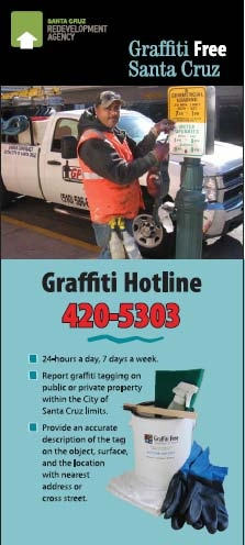 Image of graffiti technician removing graffiti from traffic sign in the Downtown Area
