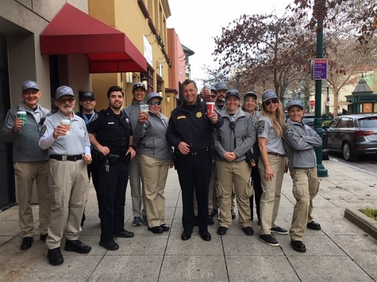 Chief and Ofc Downtown w Volunteers - small
